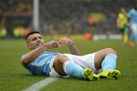 FIRING BLANKS: Sergio Aguero (above) had scored six goals in his previous six appearances against Norwich, but fails to find the net last night.