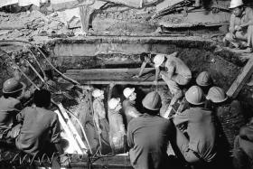 DEADLY: Rescuers digging a tunnel to reach survivors.