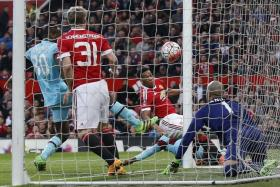 STAYING ALIVE: Anthony Martial (second from right) cancelling out Dimitri Payet's superb free-kick.