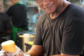 HEALTHY: Mr Rosli Mat Sham works as a helper at a roti john stall in Yishun.