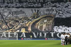READY FOR BATTLE: Italian football's aristocrats Juventus (above, right) are as formidable as their fanatical fans (top).