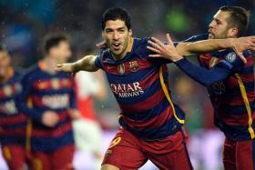 Barcelona's Luis Suarez  celebrates his superb goal during the Champions League Round of 16.