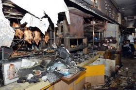 DESTROYED: (From top left) The blaze charred the entire coffee shop, leaving it in a mess. The thick smoke from the fire reached as high as six to seven storeys.