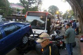 IMPACT: The impact of the accident pushed one of the motorcycles under a parked car.