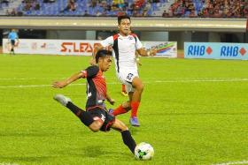 PACEY: Brunei DPMM's Maududi Hilmi's (far left) speed and versatility have caused many S.League teams problems, including Home United (in white).