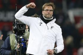 Liverpool manager Juergen Klopp celebrates in Old Trafford after his team qualified for the quarter finals of the Europa League