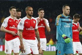 CHOKERS: Arsenal (above) have exited the Champions League at the first knockout stage for the last six seasons.