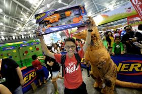 JOY: (Above) Linn Min Htoo, defending champion of the Nerf Maze Competition, with the Nerf blaster he won.