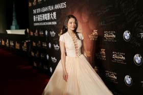Shu Qi walks walks the red carpet at the Asian Film Awards in Macau on March 17, 2016.