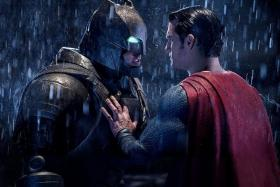 CLASH? Ben Affleck plays Batman, while Henry Cavill plays Superman in Batman v Superman: Dawn Of Justice.
