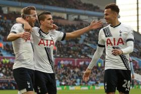 OVERJOYED: Tottenham's Harry Kane (far left) celebrating his second goal with teammates Erik Lamela (centre) and Dele Alli (left).