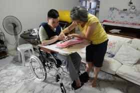 GIVING CARE: Madam Lei Shuyan with her son, Mr Li Xingjing.