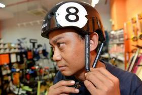 PROTECTION: Mr Arif wearing a helmet.