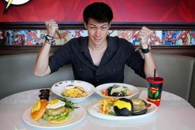 EAGER: MTV VJ Alan Wong at the DC Comics Super Heroes Cafe at Marina Bay Sands.
