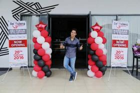 BAD LUCK: Sufi in front of De'Tulang Merah during its grand opening last month.