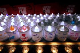 LIT UP: About 3,000 electric candles were handed out to passers-by at the Padang.