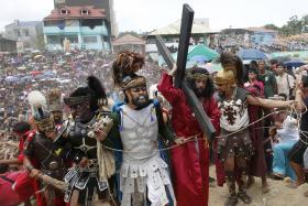 RE-ENACTMENT: (Above) Men dressed as Roman soldiers.