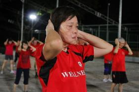 PEOPLE'S ASSOCIATION VOLUNTEER: Madam Lau An Mei is an assistant instructor at a twice-weekly exercise class held at Ulu Pandan Community Club.