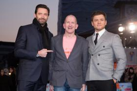 """Actors Hugh Jackman (L) and Taron Egerton (R) with Michael """"Eddie"""" Edwards at the European premiere of Eddie The Eagle, which was held on March 17 at the Odeon Leicester Square cinemas in Central London."""