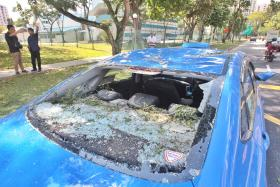 DAMAGED: (Above) The windshield of Mr Salman Salam's taxi.
