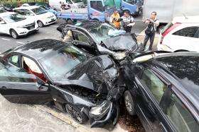 DESTROYED: Two were taken to the hospital in the six-car accident in Yishun.