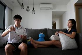 PULLING THE STRINGS: (Above) National badminton player Derek Wong stringing rackets at home with his wife Vanessa Neo, also a national shuttler.