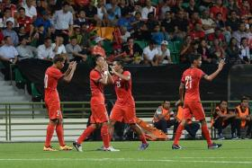 HOPE FOR THE BEST: Singapore captain Shahril Ishak (second from left) will be praying for a favourable draw for the final round of Asian Cup qualifiers.