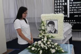 A WIFE'S GOODBYE: (Above) Mrs Angeline Aw at her husband's wake.