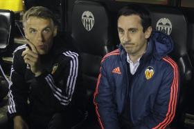 Gary Neville (right) was sacked by Valencia after taking on the head coach role for 120 days.