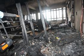 AFTERMATH: (above)The Afro Asia Building office after the fire that was started by Govindasamy Nallaiah .
