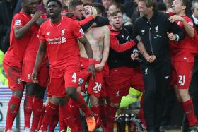 ONLY A MATTER OF TIME: Lars Ricken expects Juergen Klopp (above, in black) to bring the glory days back to Liverpool.