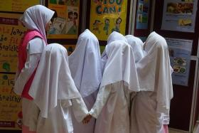 HURT: A Madrasah Al-Ma'arif Al-Islamiah teacher said on Facebook that one of the girls was kicked while the other two were hit with a bag containing a heavy item.