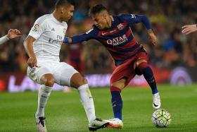 REAL STAR: Casemiro's (left) influence in breaking up Barca's attacks leaves Neymar (right), Luis Suarez and Lionel Messi frustrated.