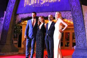ALL SMILES: (From left) Chris Hemsworth, Jessica Chastain, director Cedric Nicolas-Troyan and Charlize Theron.