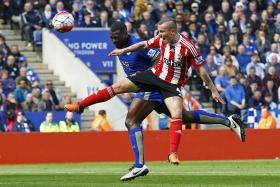 """""""We saw the (Spurs) game yesterday was a draw and wanted to make the most of our chance."""" — Leicester match-winner Wes Morgan (above, in blue)"""