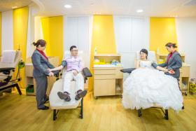 UNITED: Mr Ong Chin Hock and Miss Yeo Zhi Wei, who donated blood at Bloodbank@Dhoby Ghaut on their first date, had their wedding shoot at the blood donation centre last week.