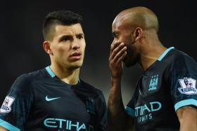 Manchester City midfielder Fabian Delph (right) claims he sees ghosts all the time. Sergio Aguero looks petrified...