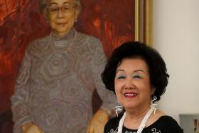 RUNS IN THE FAMILY: Mrs Betty Chen beside an oil painting of her late mother, Mrs May Wong, who was CWA president before her.