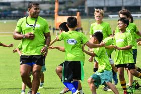 """""""The beauty of Sevens is that we cannot predict who will win."""" — Fijian rugby Sevens legend Waisale Serevi (above left, conducting a clinic for 70 kids at the Padang)"""