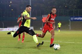 PROVIDING AMMUNITION:Jermaine Pennant swinging in another cross for Tampines Rovers, as Balestier Khalsa defender Hanafi Salleh closes in.