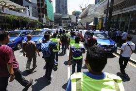 DISSENT: Traffic came to a halt after taxi drivers blocked roads in Kuala Lumpur.