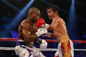 LEFT IS RIGHT: Manny Pacquiao landing a left hook on Tim Bradley en route to his win yesterday.