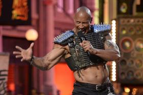 OWNING IT: Actor Dwayne Johnson (above) opens the show during the 2016 MTV Movie Awards in Los Angeles.