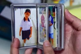 PRECIOUS: Mr Tan carries photos of Galen everywhere.