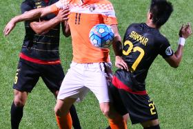 GOAL DROUGHT: Balestier striker Miroslav Kristic (No. 11) extended his barren run to 877 minutes, after drawing blanks against Kaya FC (in black) in their AFC Cup match last night.