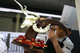 WINNERS: (Above) Mr Desmond Lee working on the chocolate showpiece.