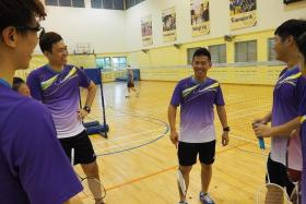 EASING THE CRUNCH: Former national doubles player Derrick Toh (centre) is glad that it will be easier to find venues for his badminton sessions.