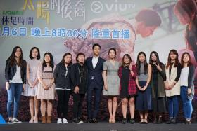 STAR-STRUCK: Descendants Of The Sun actors Song Joong Ki and Song Hye Kyo, with Hong Kong fans at the April 5 press conference. Miss Wenny Peng (first from left) and Miss Celestine Wong (in red jacket) were the only Singaporean fans at the event.