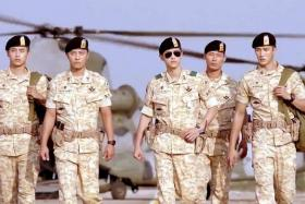 ARMY DAYS: Captain Yoo Si Jin (Song Joong Ki, with sunglasses) and Sergeant Major Seo Dae Young (Jin Goo, second from left) in a scene from Descendants Of The Sun.