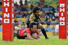 DRUBBING: Singapore's rugby men (in red) beat Brunei 47-0 en route to qualifying for the SEA 7s final against Thailand today.